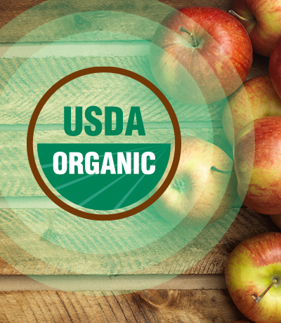 USDA Organic - Apples on a wooden surface